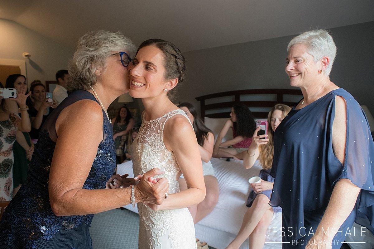 mother of the bride hugs bride