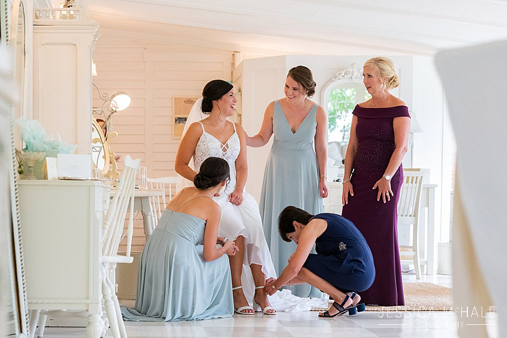 bride and bridesmaids at the cottage house