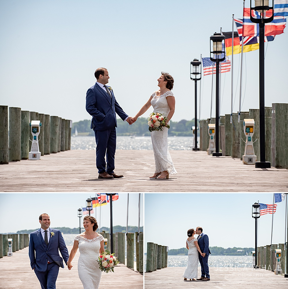 Bride and Groom on the dock at their Herreshoff Maritime Museum Wedding