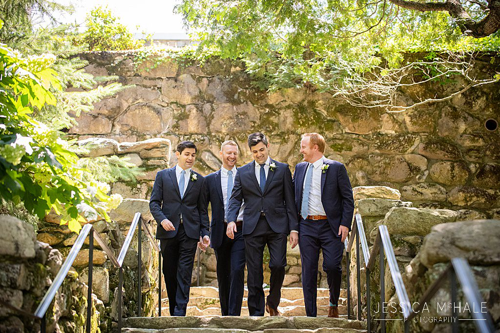 groomsmen on stairs at connors center dover wedding