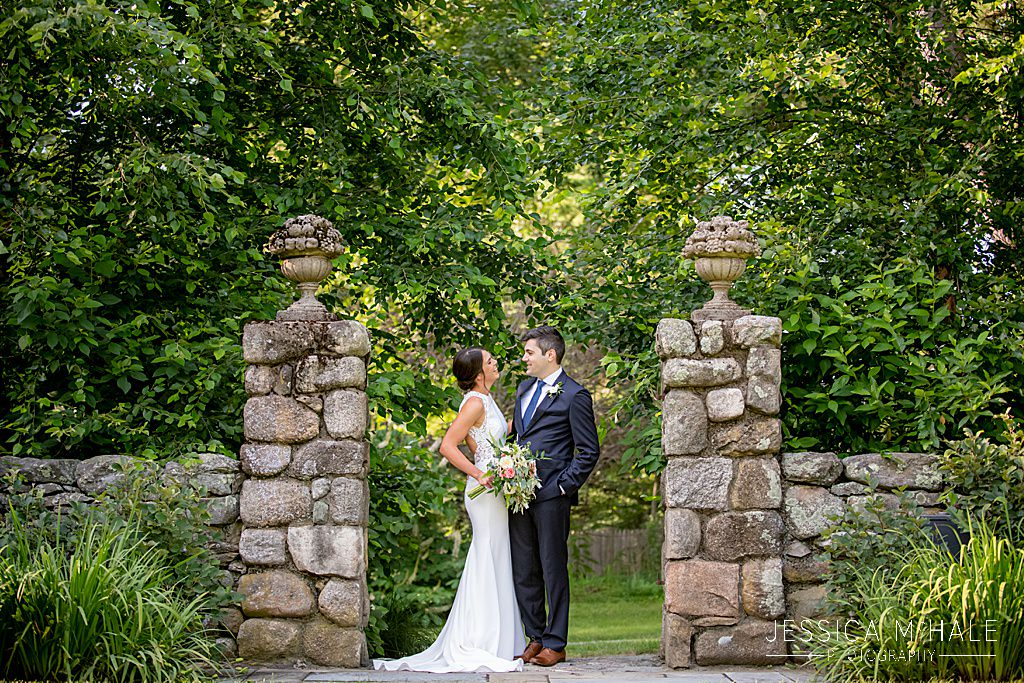wedding photos bride and groom near stone pillars outside connors center dover ma